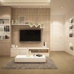 ein Wohnzimmer in weiss und grau mit intensiver möbelbeleuchtung