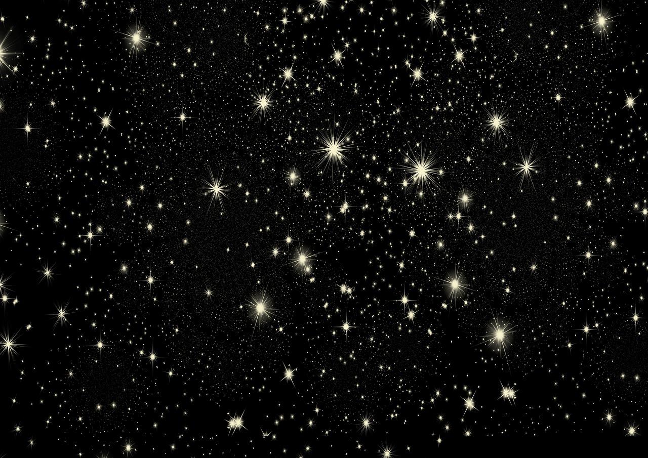 Ein schwarzer Nachthimmel mit gelben Sternen in unterschiedlichen Größen.